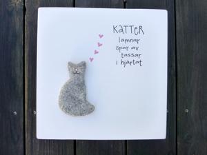 Katter lämnar spår av tassar i hjärtat